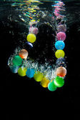 Beads under water — Stock Photo