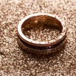Golden ring on golden sand. - Stock Photo