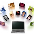A laptop and digital pictures flying. — Stock Photo