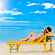 Young woman relaxing on beach — Stock Photo #6746119