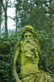 Old Figure with moss — Stockfoto