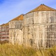 Stock Photo: Wooden Grain Storage Bins