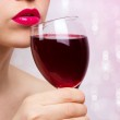 Young beautiful woman with wine — Stock Photo