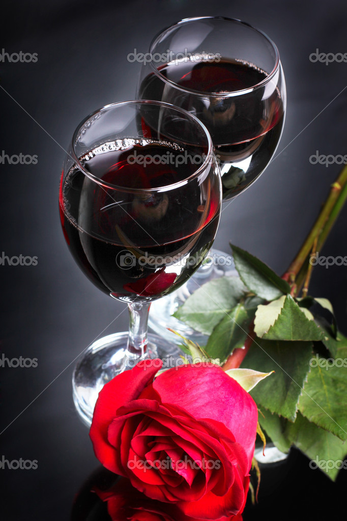 Two goblet of wine with one rose — Stock Photo #5652142