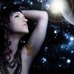 Beautiful woman over universe — Stock Photo