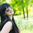 Beautiful young woman wearing sunglasses — Stock Photo