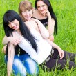 Three smiling girl-friends — Stock Photo