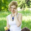 Mother with son relaxing outdoor — Stock Photo