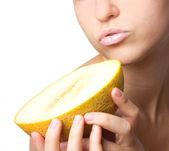 Beautiful woman with melon — Stock Photo