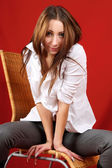 Beautiful young woman sat on a chair — Stock Photo