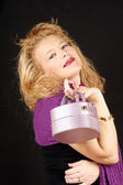 Blond woman with handbag — Stock Photo