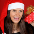 Santa Claus girl shaking Christmas present — Foto de Stock