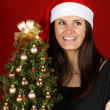 Santa Claus girl with Christmas tree — Stock Photo