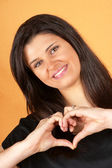Young woman making heart with hands — Stock Photo