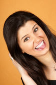 Young woman sticking out her tongue — Stock Photo
