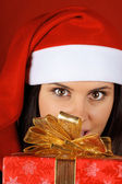 Santa Claus girl offering Christmas present — Stock Photo
