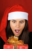 Santa Claus girl with Christmas present — Stock Photo