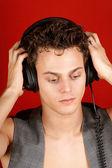 Disc jockey with earphones — Stock Photo