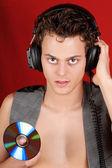 Disc jockey with earphones and cd — Stock Photo