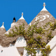 Trulli of Alberobello in Apulia - Stock Photo