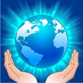 Globe in handen — Stockvector