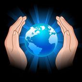 Globe in hands — Stock Vector