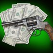 Money and gun — Stock Photo