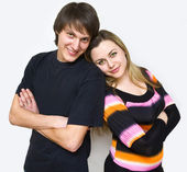 Happy couple of young adults portrait smiling — Stock Photo