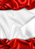 Red and white satin fabric background — Stock Photo