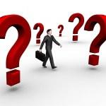 Businessman walk in question — Stock Photo