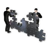 Businessmens bilding puzzle — Stock Photo