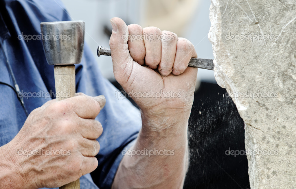 A stone carver at work  Stock Photo #5806824