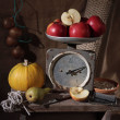 One kilogram of apples. Old spring-balance. - Stock Photo