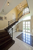 Modern entrance hall w stairway — Stock Photo