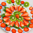 Fresh strawberries and kiwi fruit sliced ​​on a plate — Stock Photo