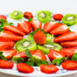 Fresh strawberries and kiwi fruit sliced ​​on a plate — Stock Photo #5421118