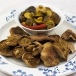 Marinaded with dried mushrooms in a bowl — Stok fotoğraf