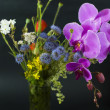 Stock Photo: Bouquet of summer fresh wild flowers isolated on black background