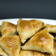 Asian pies with meat samsa, on the black background — Stock Photo #6001242