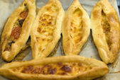 Turkish food pide, yeast dough cheese and butter. — Stock Photo