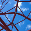Red cords against the blue sky. The red web. - Stock Photo