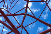 Red cords against the blue sky. The red web. — Stock Photo