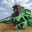 Combine in the field on harvesting. - Stock Photo