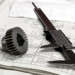 Stock Photo: Gears and electronic calliper