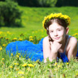 Girl lying on grass — Stok fotoğraf