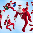 Santas Clause break-dancers — Stock Photo