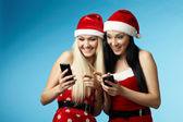 Christmas women with phones — Stock Photo