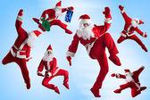 Santas Clause break-dancers — Stock Photo