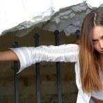Girl near the fence — Stock Photo