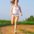Sports girl runs in the forest — Stock Photo